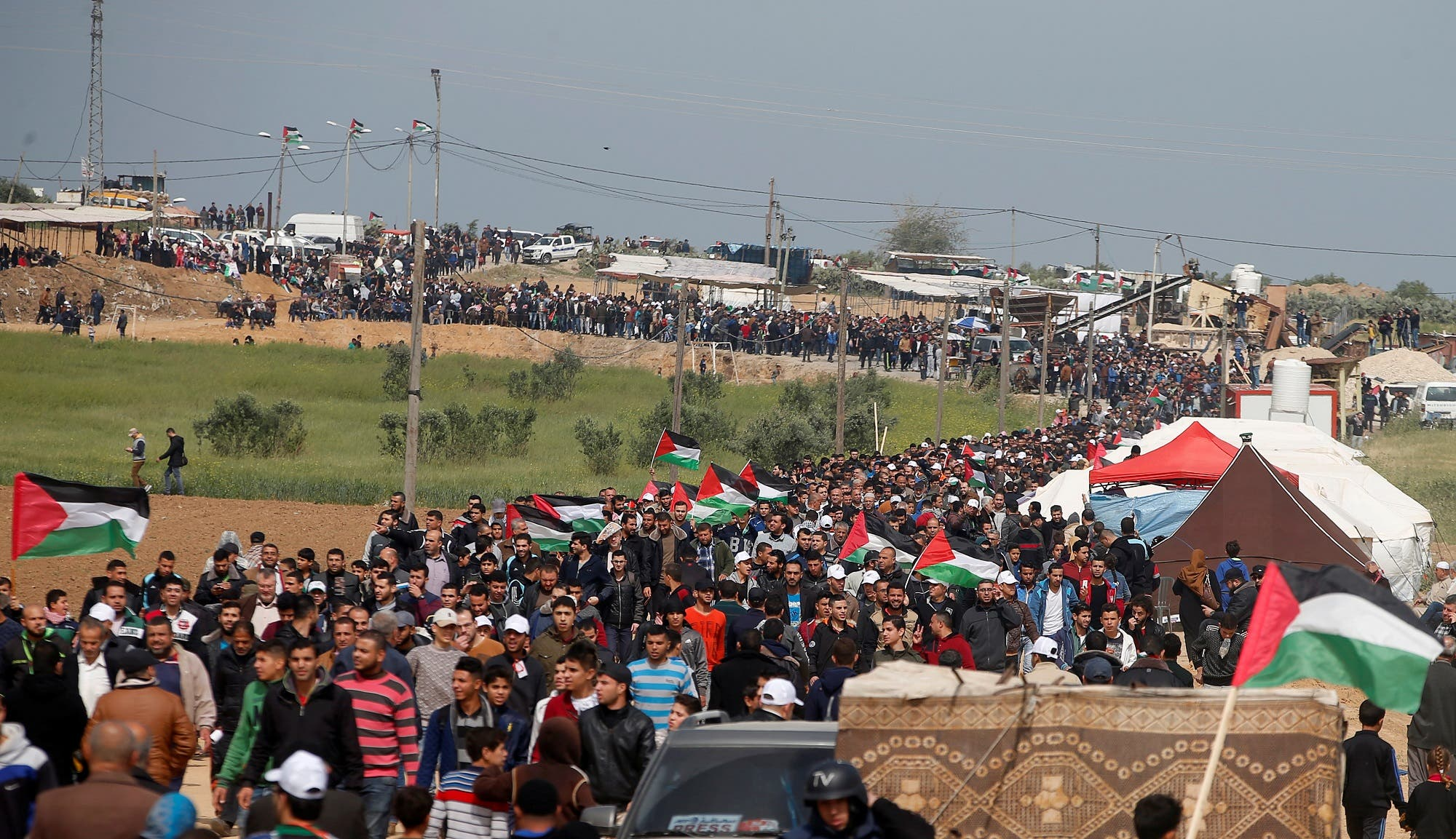 Palestinians attend a tent city protest along the Israel border with Gaza, demanding the right to return to their homeland, east of Gaza City March 30, 2018. REUTERS