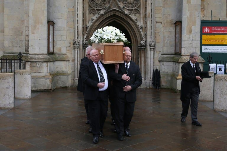 Six porters of Gonville & Caius College, act as pallbearers and carry the coffin of British scientist Stephen Hawking after the funeral service at the Church of St Mary the Great, in Cambridge on March 31, 2018. Friends, family and colleagues of British scientist Stephen Hawking gathered on March 31, 2018, to pay their respects at his private funeral in Cambridge, where he spent most of his extraordinary life. Daniel LEAL-OLIVAS / AFP