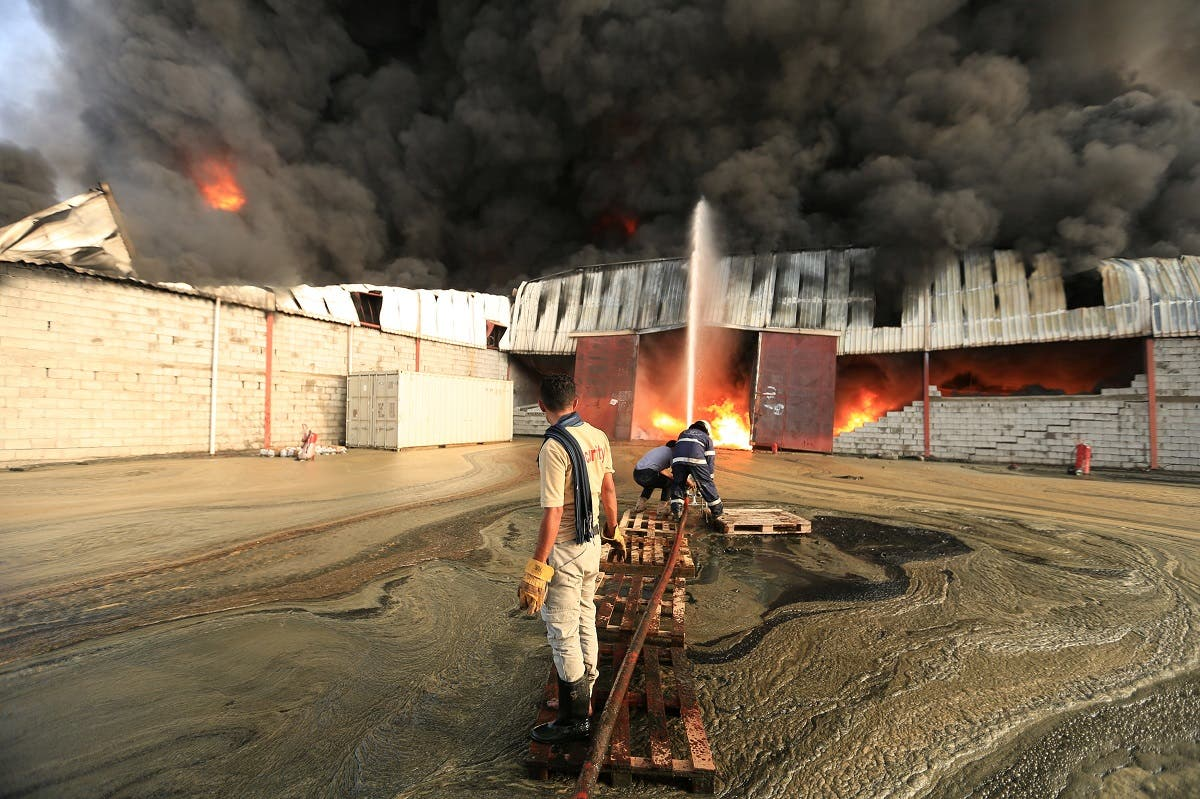 Firefighters try to extinguish a fire engulfing warehouse of the World Food Programme in Hodeida, Yemen. (Reuters)