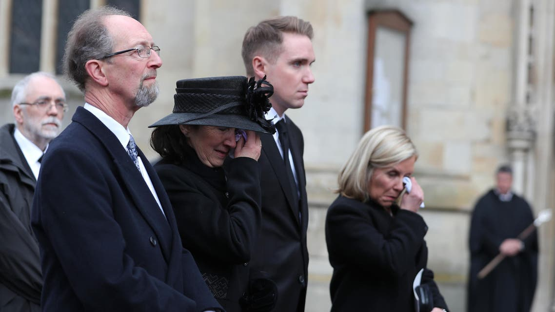 Jane Hawking (C), first wife of Stephen Hawking, his son Tim (2R) and daughter Lucy Hawking, follow the coffin of British scientist Stephen Hawking after the funeral service at the Church of St Mary the Great, in Cambridge on March 31, 2018. Friends, family and colleagues of British scientist Stephen Hawking gathered on March 31, 2018, to pay their respects at his private funeral in Cambridge, where he spent most of his extraordinary life. (AFP)