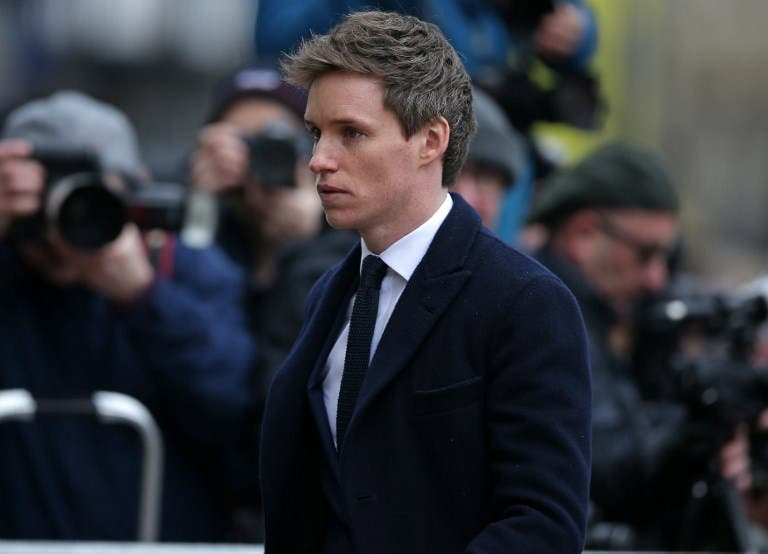 British actor Eddie Redmayne, who played Stephen Hawking in The Theory of Everything, arrives to attend the funeral of British scientist Stephen Hawking at the Church of St Mary the Great, in Cambridge on March 31, 2018. Friends, family and colleagues of British scientist Stephen Hawking gathered to pay their respects at his private funeral in Cambridge, where he spent most of his extraordinary life. Daniel LEAL-OLIVAS / AFP