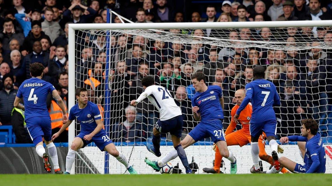 Dele Alli (center) scores Tottenham's third goal against Chelsea during the English Premier League soccer match at Stamford Bridge stadium in London, on April 1, 2018. (AP)