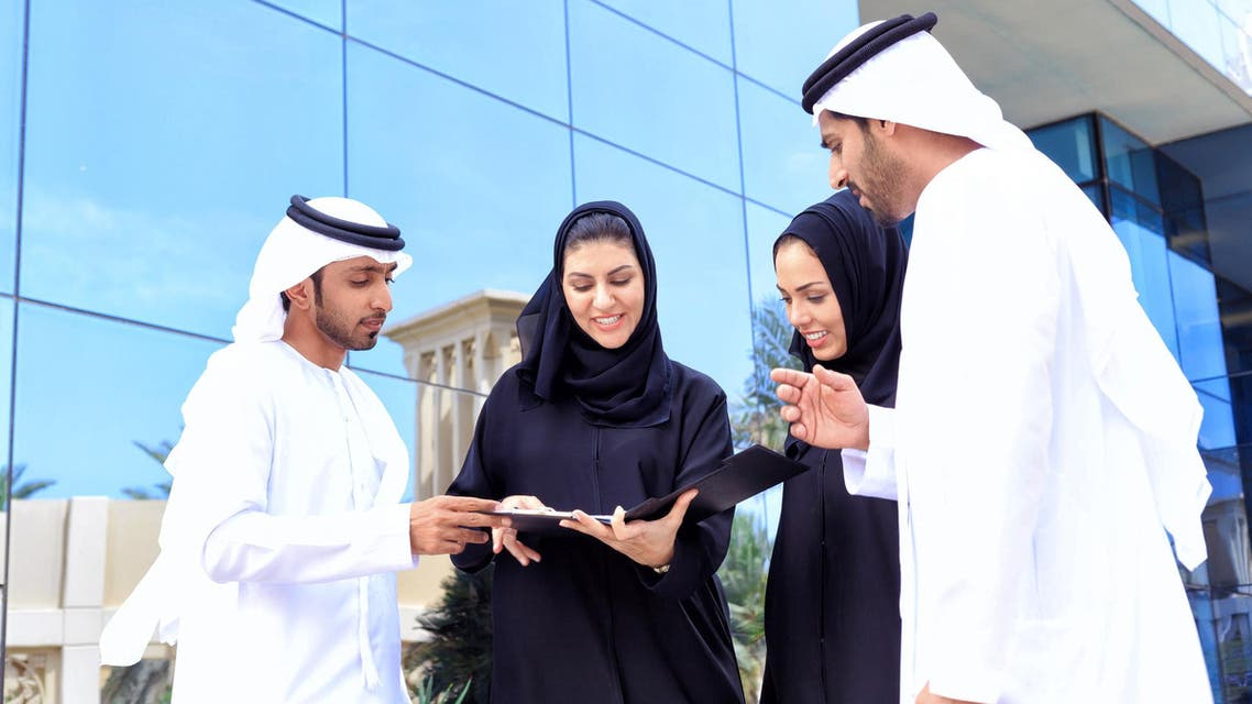 Four arab business people outside - Stock image...