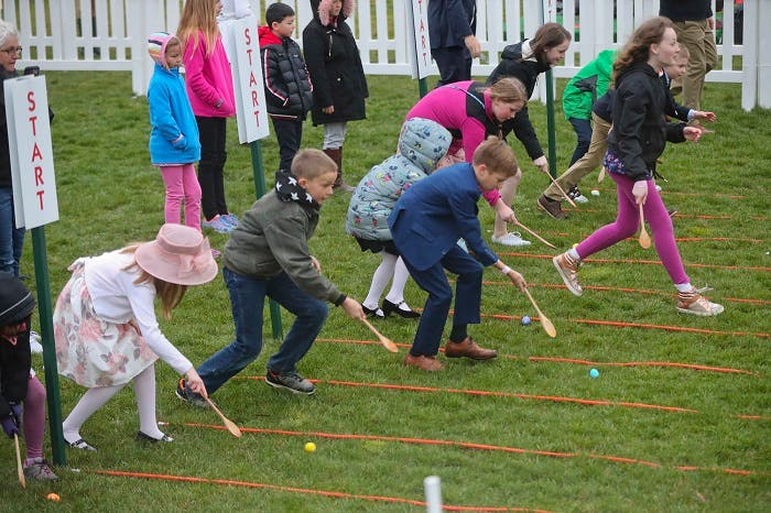 Children participate in the annual White House Easter Egg Roll on the South Lawn of the White House in Washington, Monday, April 2, 2018. (AP