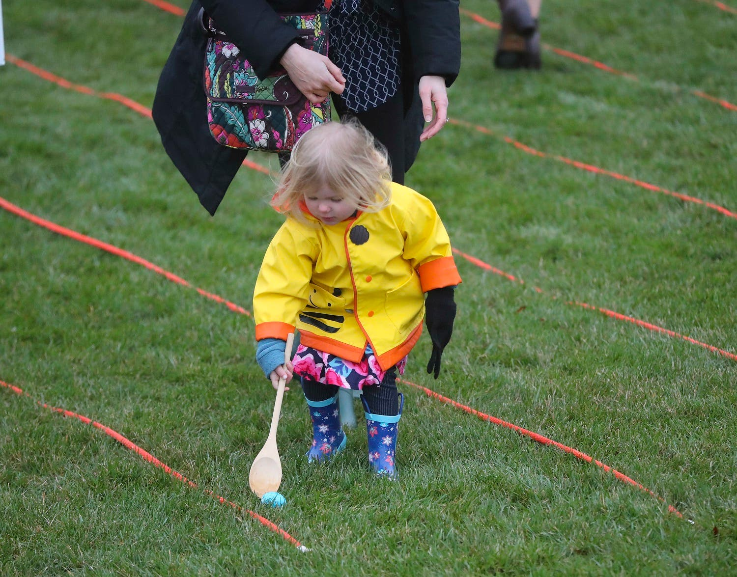 A child participates in the annual White House Easter Egg Roll on the South Lawn of the White House in Washington, Monday, April 2, 2018. (AP