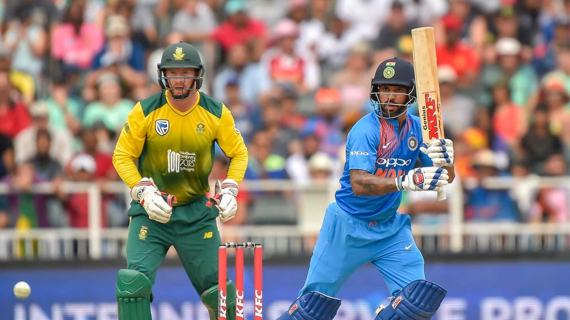 ndia's batsman Shikhar Dhawan (R) is watched by South Africa's wicketkeeper Heinrich Klaasen. (AFP)