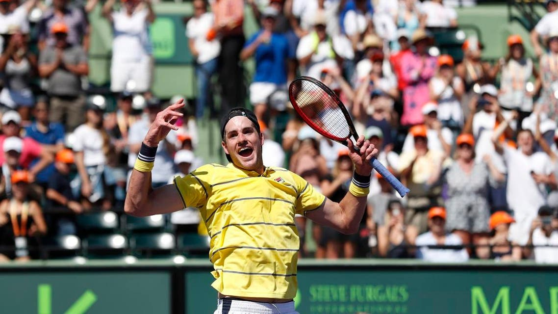 John Isner of the United States celebrates celebrates after match point against Alexander Zverev of Germany (not pictured) in the men's singles final of the Miami Open at Tennis Center at Crandon Park. 6-7(4), 6-4, 6-4. Mandatory Credit: Geoff Burke-USA TODAY Sports