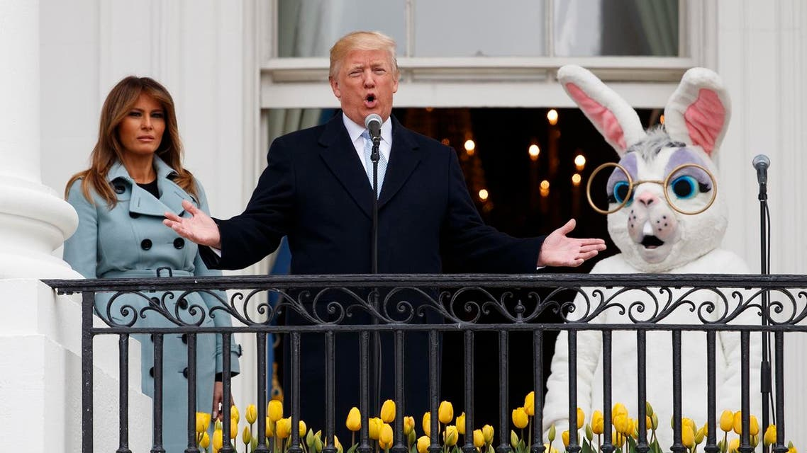 President Donald Trump, joined by the Easter Bunny and first lady Melania Trump speaks from the Truman Balcony of the White House in Washington, Monday, April 2, 2018, during the annual White House Easter Egg Roll. AP