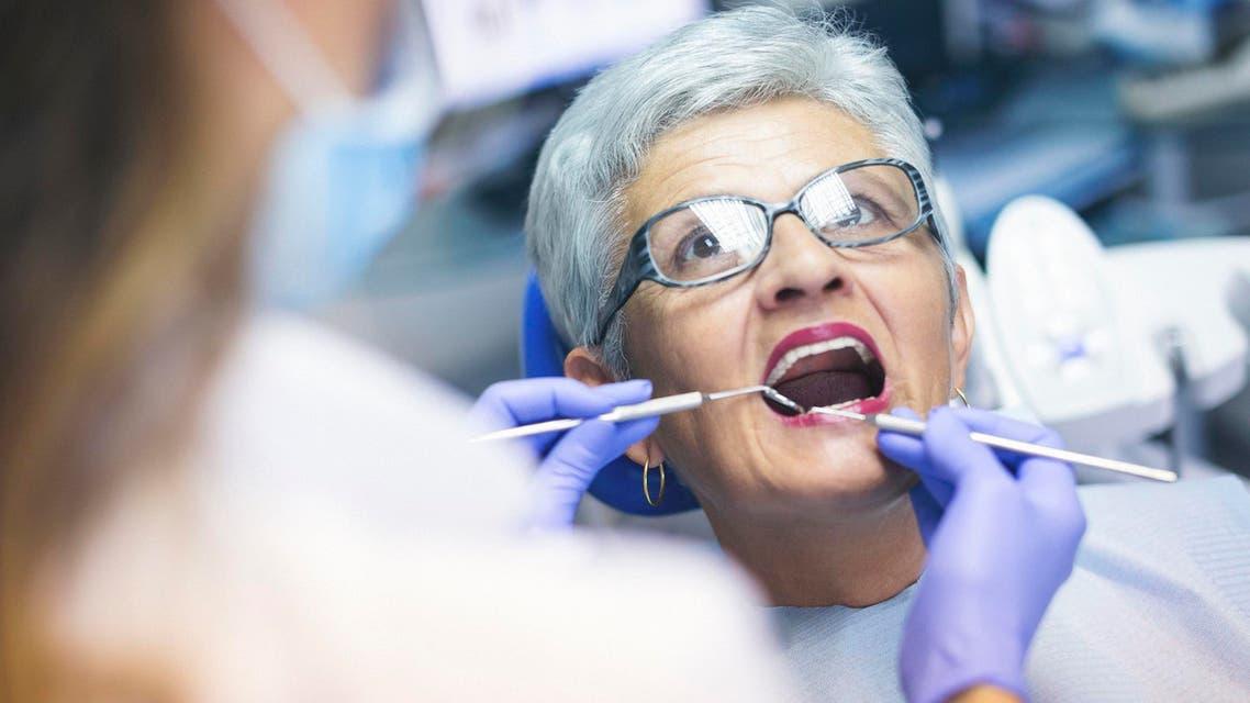 Senior female patient at dentist office - Stock image...