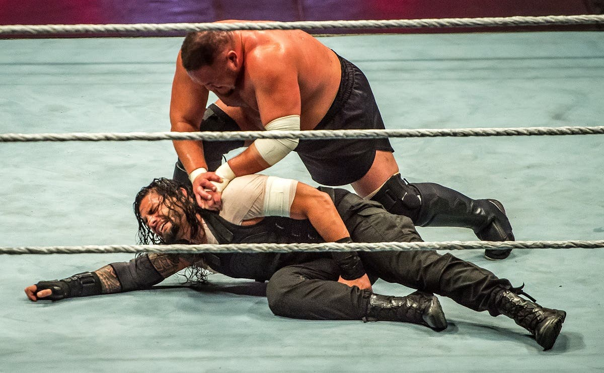 Roman and Samoa Joe (R) battle during the WWE show at Zenith Arena on may 09, 2017 in Lille, France. (AFP)