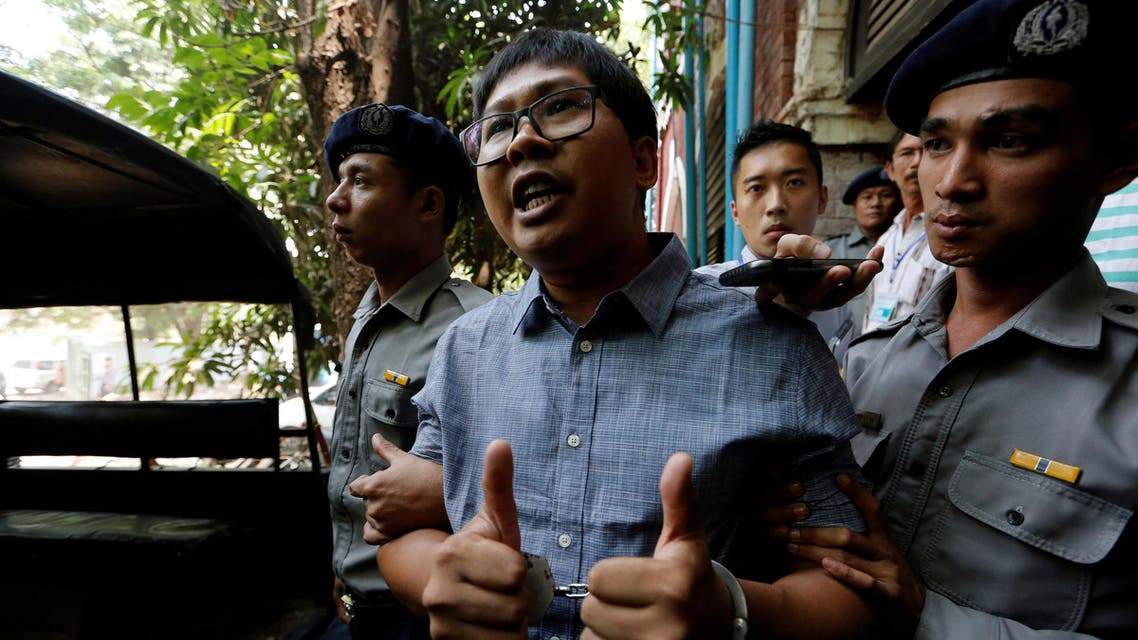 Detained Reuters journalist Wa Lone is escorted by police after a court hearing in Yangon, Myanmar April 4, 2018. REUTERS/