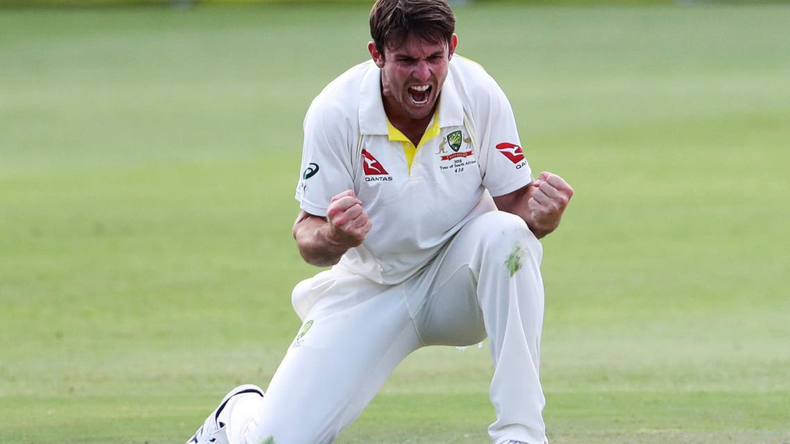 Cricket - South Africa vs Australia - Second Test - St George's Park, Port Elizabeth, South Africa - March 10, 2018. Australia's Mitchell Marsh celebrates taking the wicket of South Africa's Theunis de Bruyn. REUTERS/Mike Hutchings