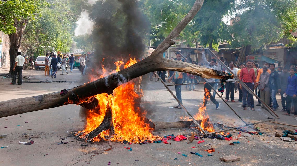 India's lower caste Dalits burn a dead tree to block traffic during a nationwide strike in Ahmadabad on April 2, 2018. (AP)