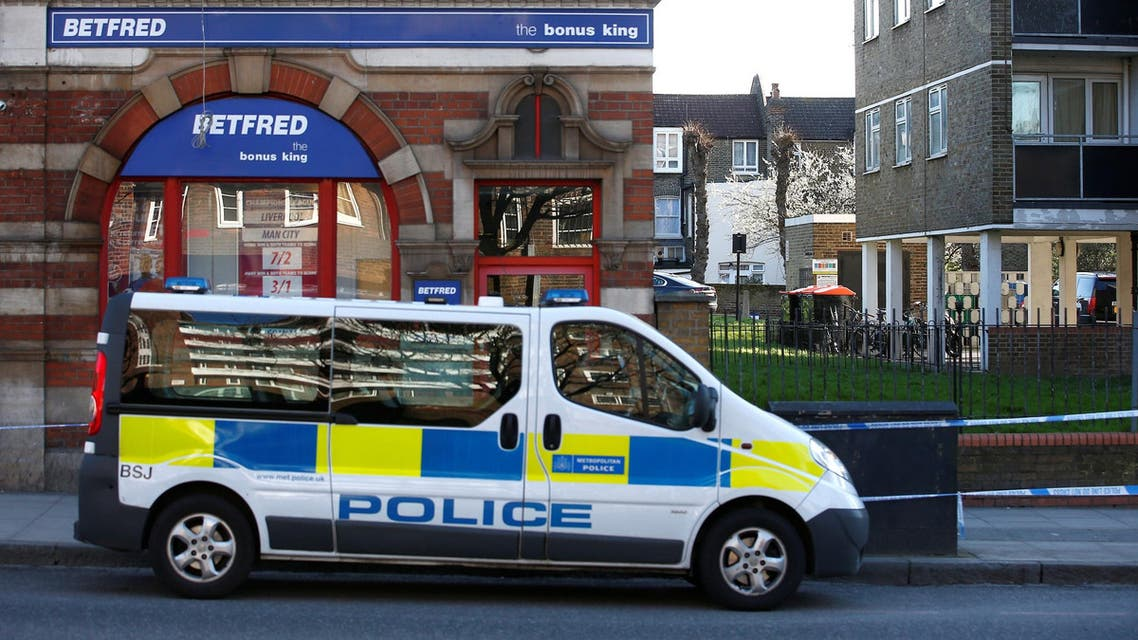 A police van parked at the Upper Clapton Road in east London where a man died from stab wounds on the night of April 4, 2018. (Reuters)