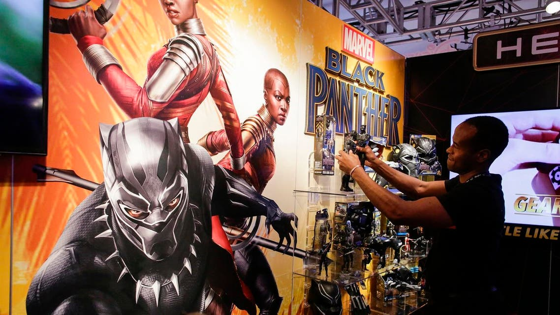 An exhibitor organizes 'Black Panther' items at the Hasbro showroom during the annual New York Toy Fair, on February 20, 2018, in New York. (AFP)