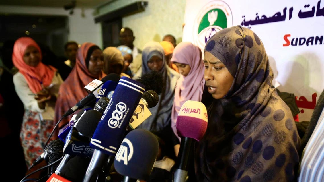 A Sudanese female member of the ISIS speaks to journalists after a group was brought to Khartoum on April 4, 2018 from Libya where they had gone three years ago to join the militant group. (AFP)