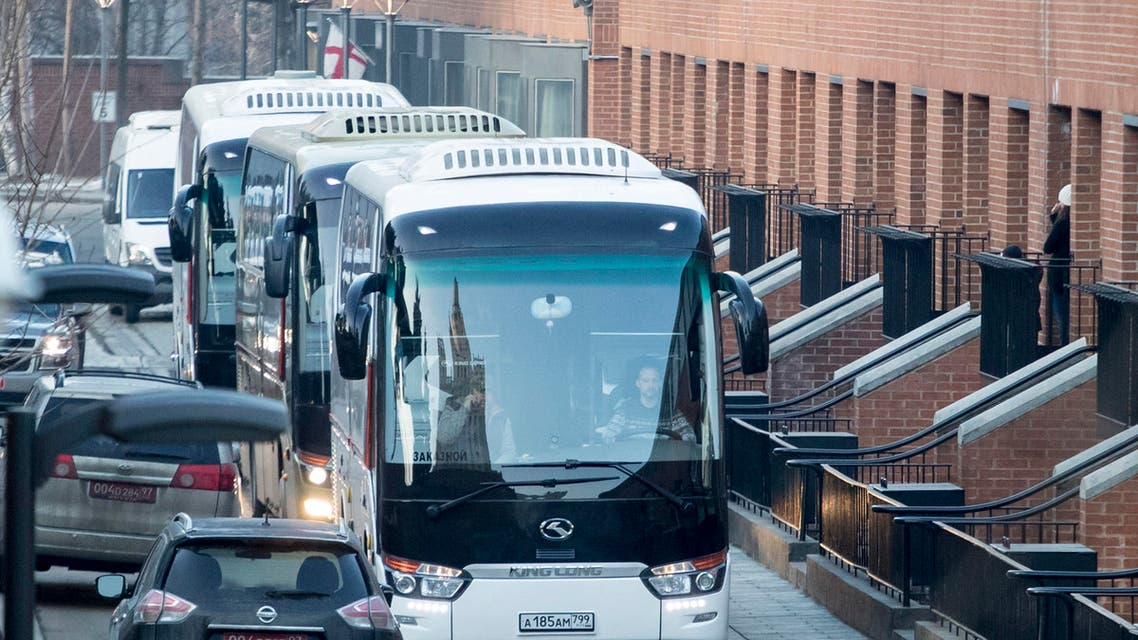 Buses believed to be carrying expelled diplomats prepare to leave the U.S. Embassy in Moscow, Russia, Thursday, April 5, 2018. (AP)