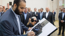 Crown Prince Mohammed bin Salman signs first Saudi satellite at Lockheed Martin