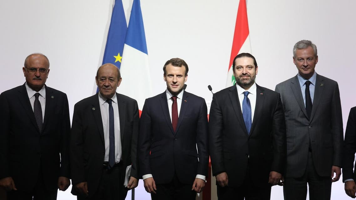 (L-R) Lebanese politician Ali Hassan Khalil, French Foreign Affairs Minister Jean-Yves Le Drian, French President Emmanuel Macron, Lebanese Prime Minister Saad Hariri and French Economy Minister Bruno Le Maire pose during the International CEDRE Conference in Paris. (AFP)