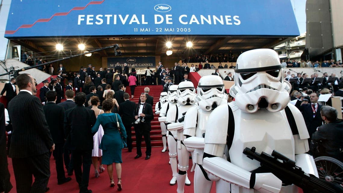 """Storm-troopers patrol during red carpet arrivals for the screening of [US director George Lucas's] film """"Star Wars - Episode III - Revenge of the Sith"""" at the 58th Cannes Film Festival May 15, 2005. (Reuters)"""