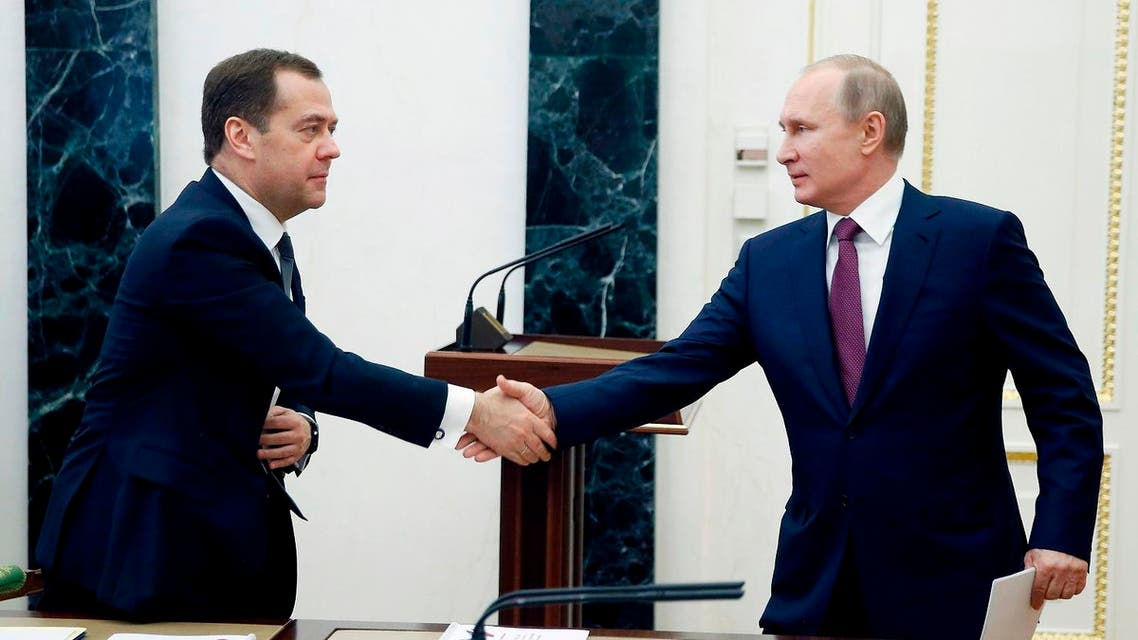 Russian President Vladimir Putin, right, shakes hands with Russian Prime Minister Dmitry Medvedev as he arrives to attend a Security Council meeting in Moscow, Russia, Friday, April 6, 2018. AFP