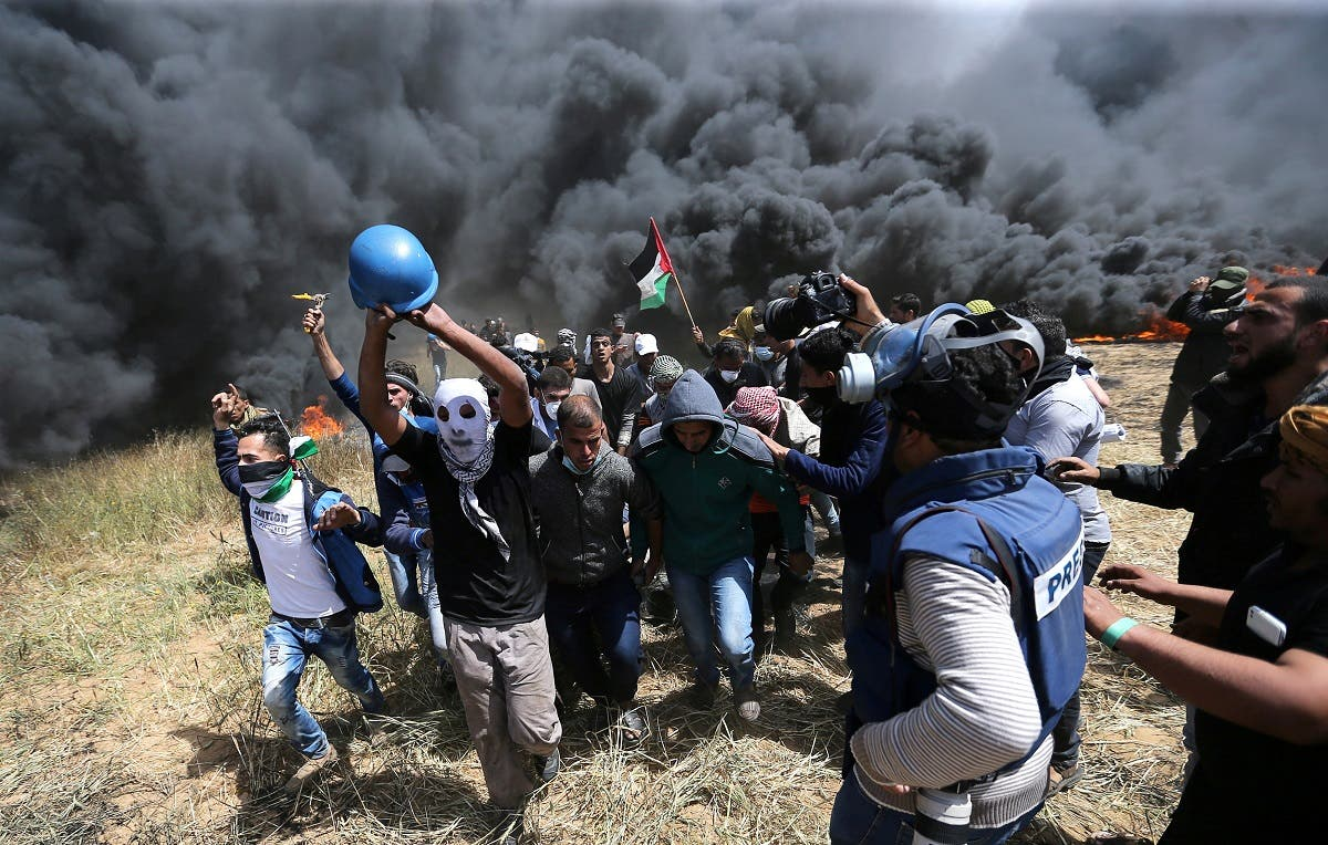 Palestinians evacuate mortally wounded Palestinian journalist Yasser Murtaja, 31, during clashes with Israeli troops at the Israel-Gaza border, in the southern Gaza Strip. (Reuters)