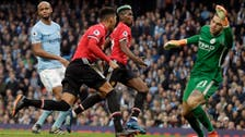 Man City collapses to United, delaying EPL title party