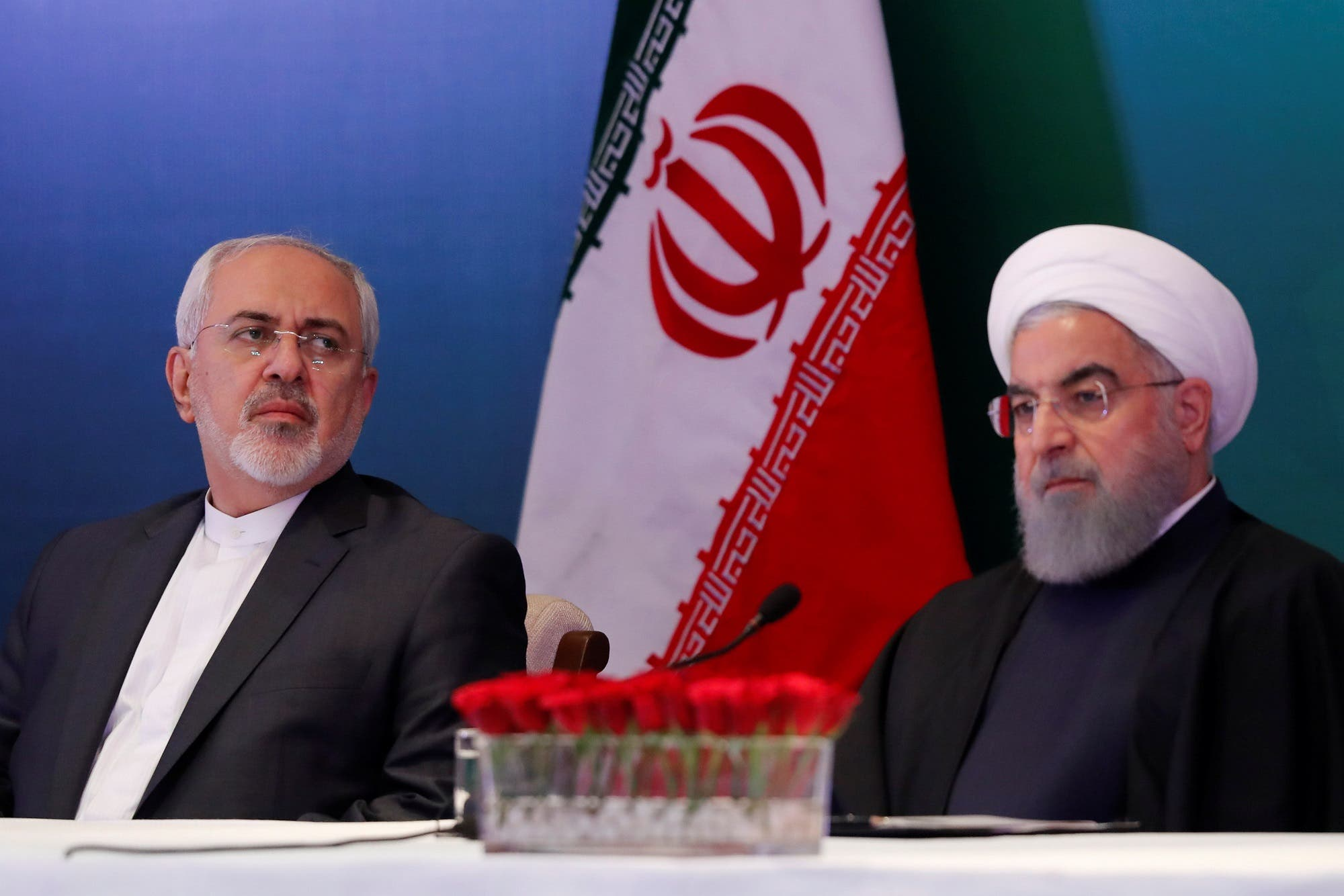 Iranian President Hassan Rouhani (R) and Foreign Minister Mohammad Javad Zarif attend a meeting in Hyderabad, India, on February 15, 2018. (Reuters)
