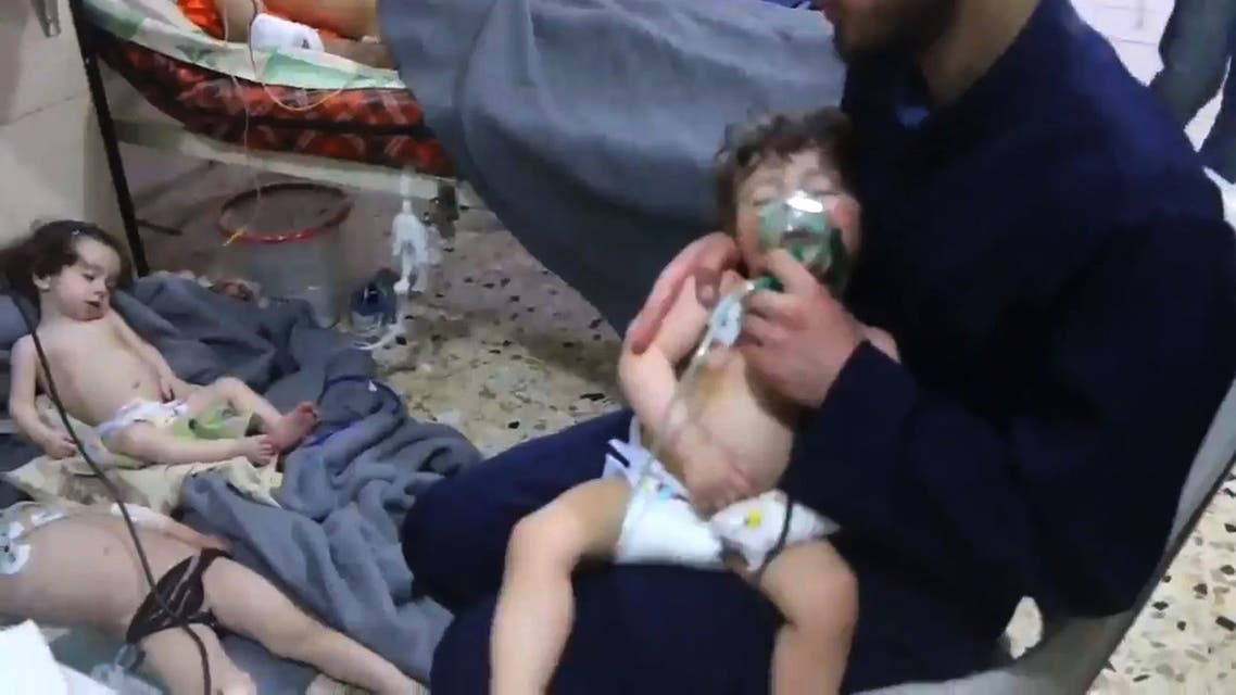 """An image grab taken from a video released by the Syrian civil defence in Douma shows unidentified volunteers giving aid to children at a hospital following an alleged chemical attack on the rebel-held town on April 8, 2018. A suspected chemical attack by Syria's regime sparked international outrage, after rescue workers reported dozens killed by poison gas on rebel-held parts of Eastern Ghouta near Damascus. President Bashar al-Assad's regime and its ally Russia denied the allegations of a chlorine gas attack on the town of Douma, calling them """"fabrications"""".   HO / AFP / SYRIA CIVIL DEFENCE"""