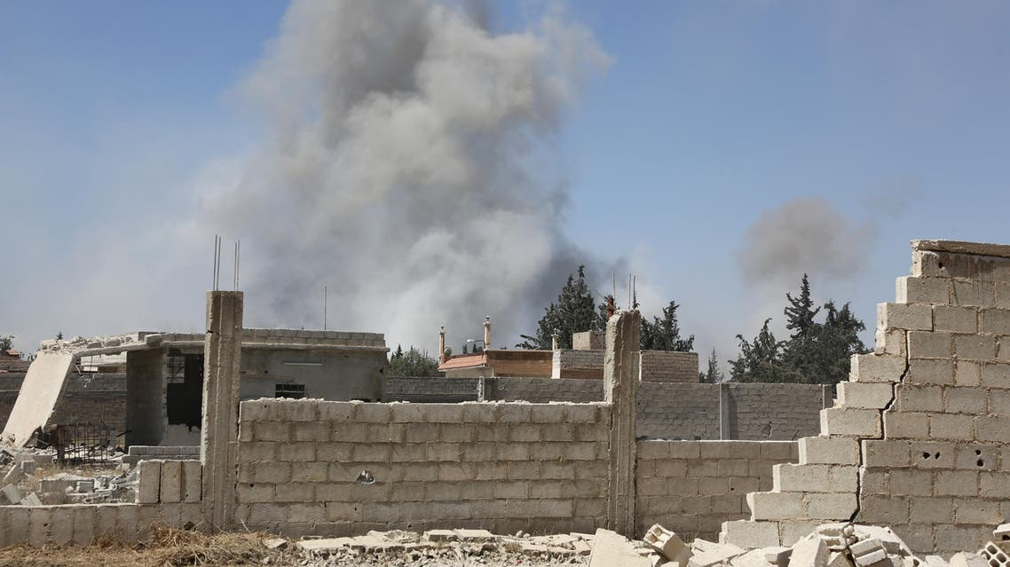 Smoke billows in the town of Douma, the last opposition holdout in Syria's Eastern Ghouta, on April 7, 2018, after Syrian regime troops resumed a military blitz to pressure rebels to withdraw. Backed up by Russia's firepower, Syrian President Bashar al-Assad has ousted his armed opponents from nearly all of Ghouta, their last stronghold on the edge of the capital. The regime has used a combination of a fierce military onslaught and two negotiated withdrawals to empty out 95 percent of the enclave, but rebels are still entrenched in its largest town of Douma.   STRINGER / AFP