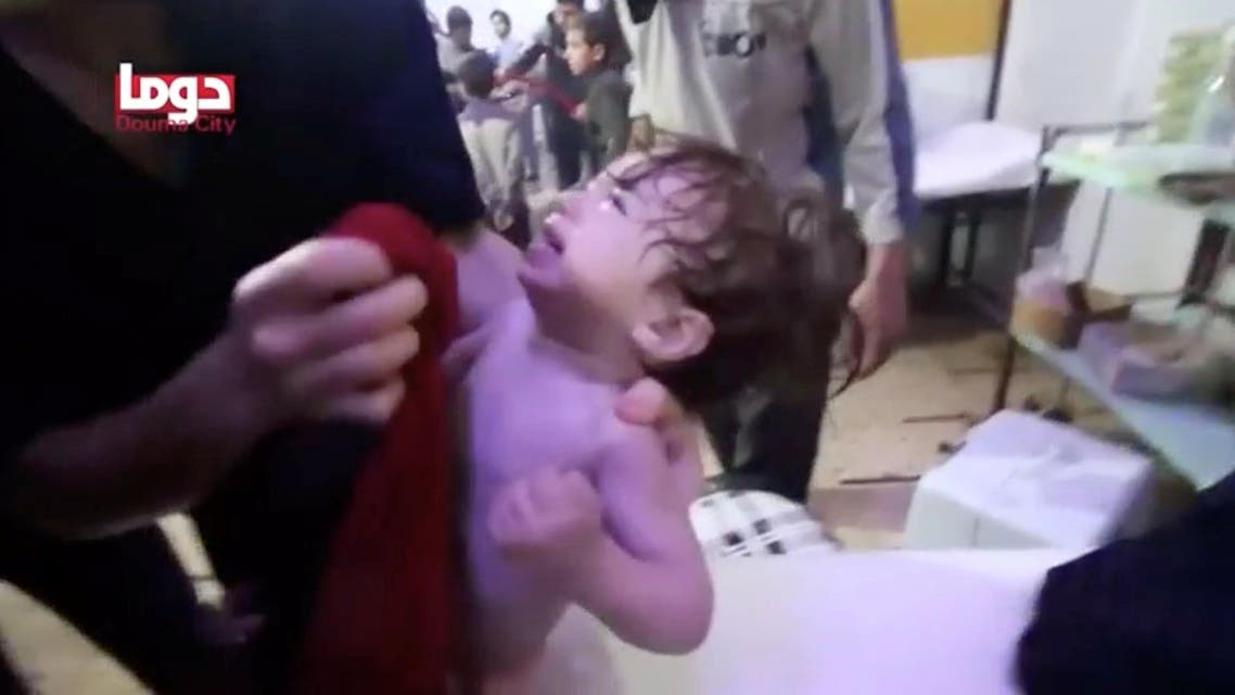 A child cries as they have their face wiped following alleged chemical weapons attack, in what is said to be Douma, Syria in this still image from video obtained by Reuters on April 8, 2018. (Reuters)