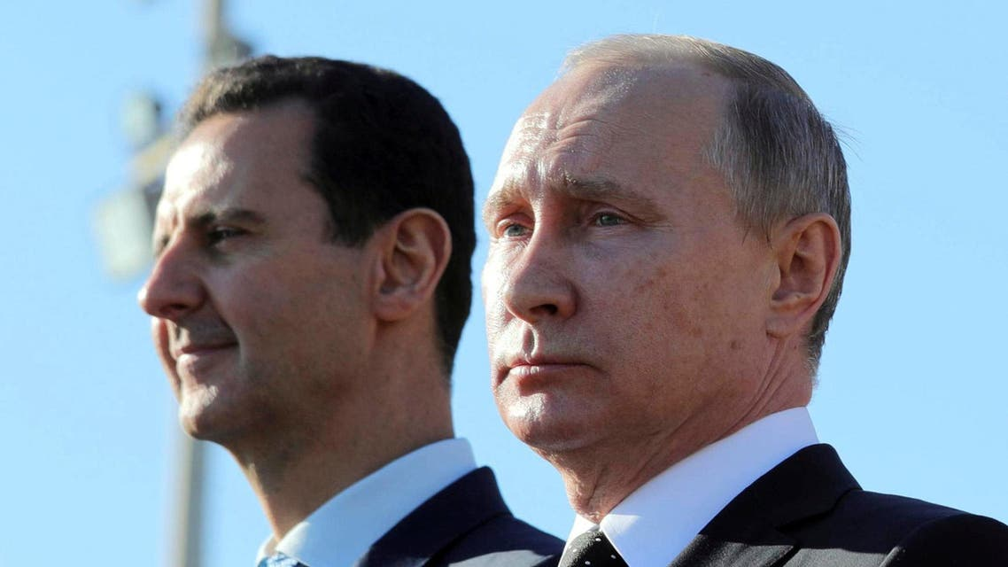 Vladimir Putin with Bashar al-Assad at the Hmeymim air base in Latakia on December 11, 2017. (Reuters)