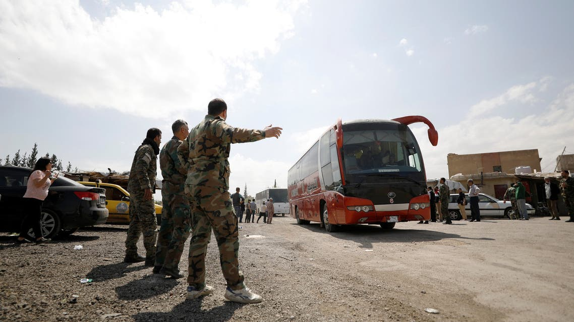 Buses carry rebels and their families who left Douma, at Wafideen camp in Damascus, Syria, April 9, 2018. REUTERS/Omar Sanadiki