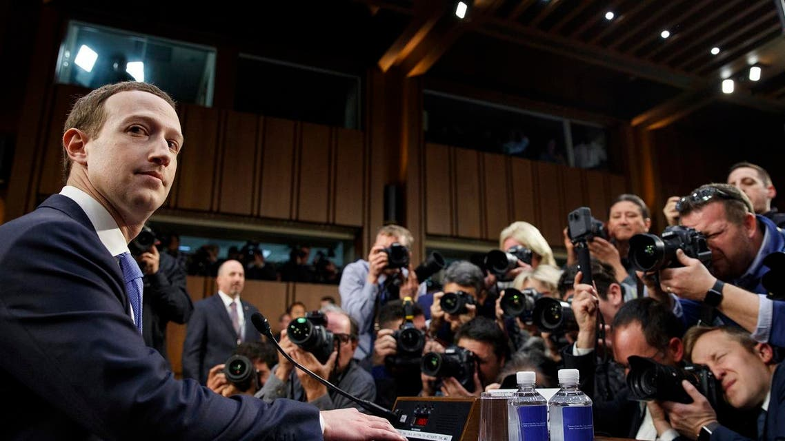 Facebook CEO Mark Zuckerberg takes his seat as he arrives to testify before a joint hearing of the Commerce and Judiciary Committees on Capitol Hill in Washington, Tuesday, April 10, 2018, about the use of Facebook data to target American voters in the 2016 election. (AP)