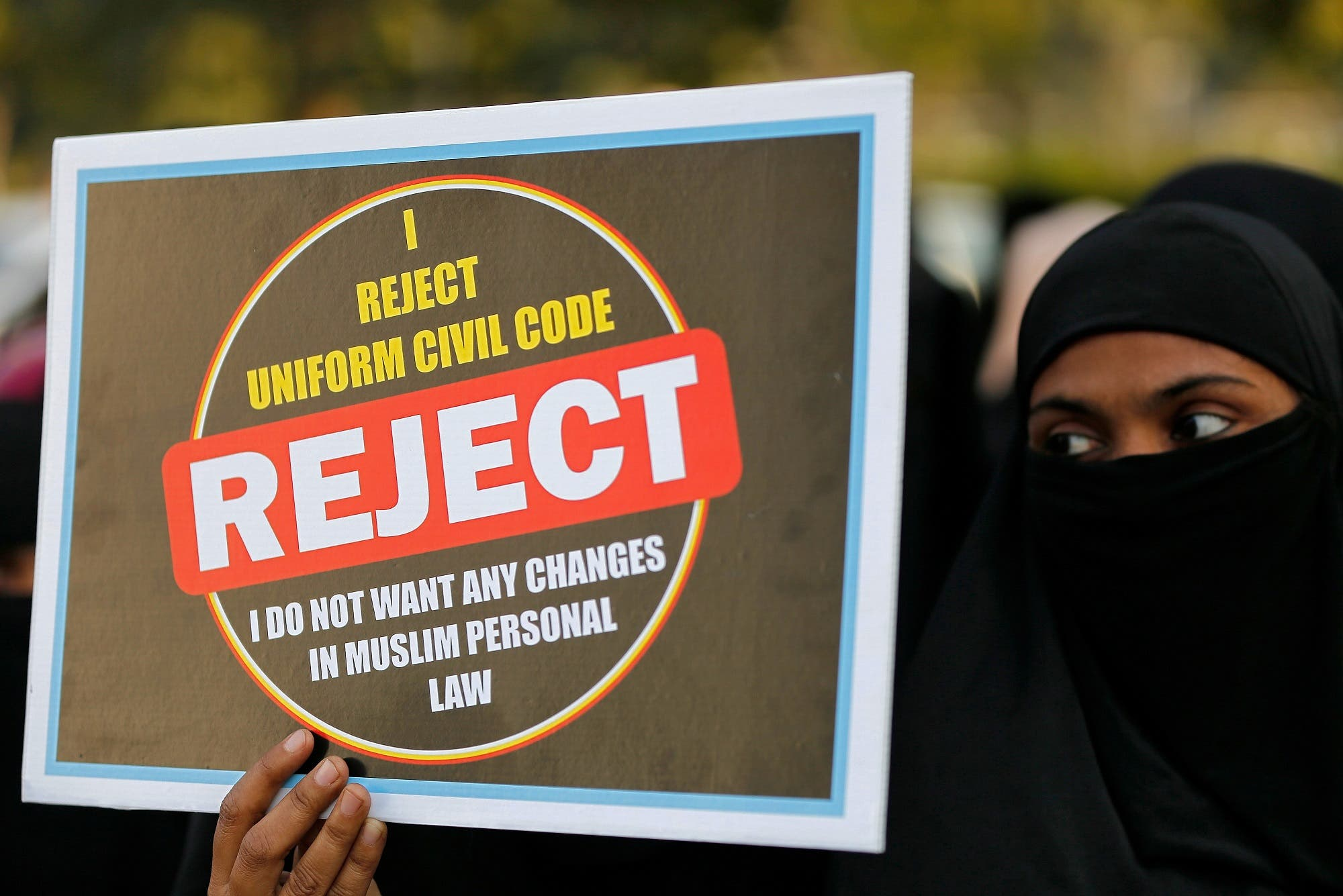 "A Muslim woman displays a placard during a protest against ""triple talaq"" bill in Ahmedabad on January 7, 2018. (Reuters)"