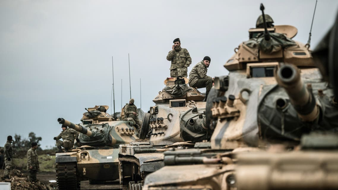 Turkish army tanks gather close to the Syrian border on January 21, 2018 at Hassa, in Hatay province. Turkish forces on January 20, 2018, began a major new operation aimed at ousting the Peoples' Protection Units (YPG) Kurdish militia from Afrin, pounding dozens of targets from the sky in air raids and with artillery. Turkey accuses the YPG of being the Syrian offshoot of the Kurdistan Workers' Party (PKK) which has waged a rebellion in the Turkish southeast for more than three decades and is regarded as a terror group by Ankara and its Western allies.  BULENT KILIC / AFP