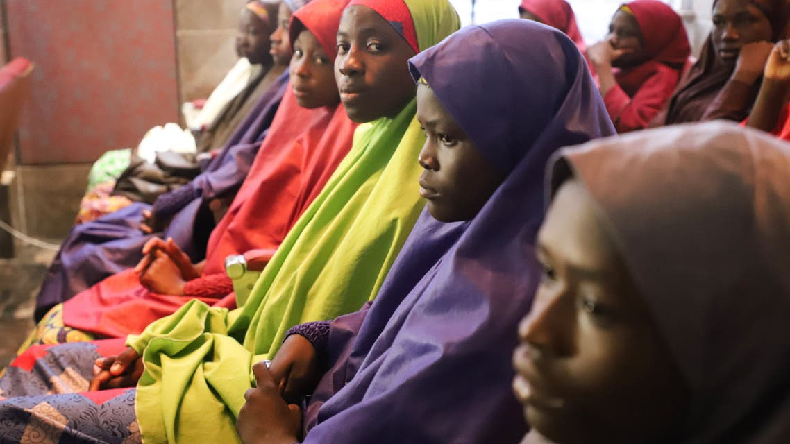 Released Nigerian school girls who were kidnapped from their school in Dapchi, in the northeastern state of Yobe, wait to meet the Nigerian president at the Presidential Villa in Abuja on March 23, 2018. The Nigerian president promised on March 23, 2018 to free the remaining Christian schoolgirl still held by the Islamist militants Boko Haram, as he prepared to meet the other released Dapchi students. A total of 104 of the 110 students seized from the school in Dapchi on February 19 were released on March 21, 2018. PHILIP OJISUA / AFP