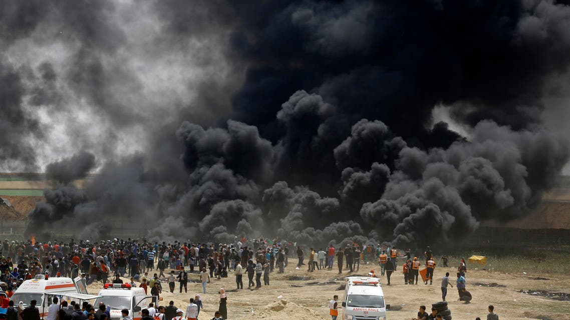 Palestinians burn tires at the border fence with Israel, east of Jabalia in the central Gaza city, during a protest on April 13, 2018. Several thousand Gazans gathered for a third consecutive Friday of mass protests along the border with Israel after violence in which Israeli forces have killed 33 Palestinians and wounded hundreds of others. (AFP)