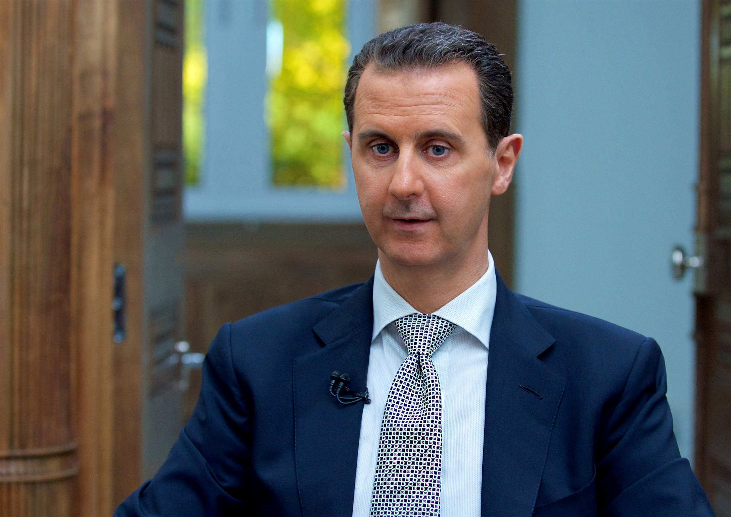 Syria's President Bashar al-Assad speaks during an interview with AFP news agency in Damascus, Syria in this handout picture provided by SANA on April 13, 2017.