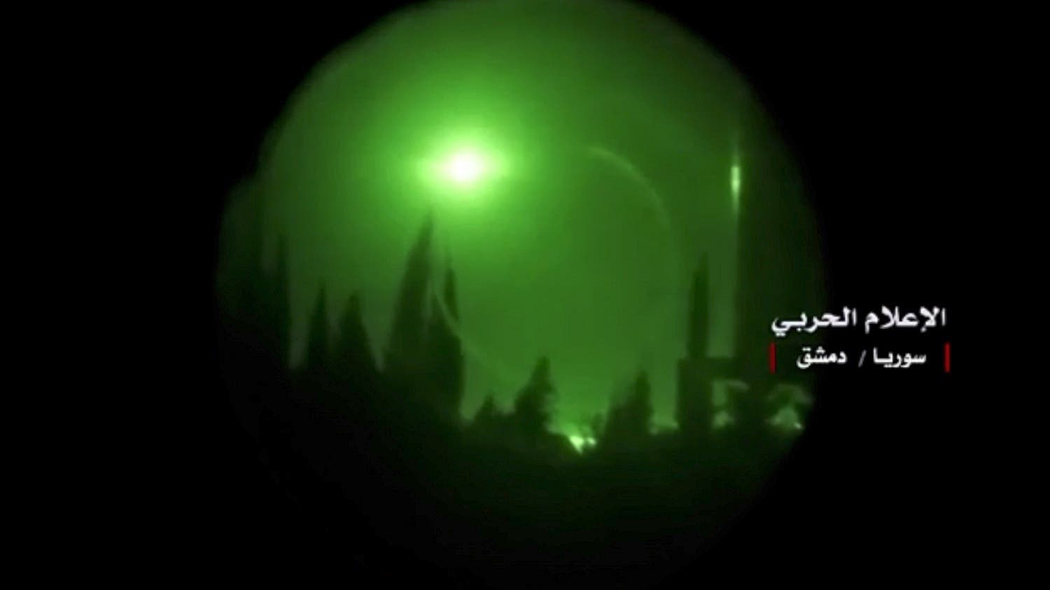 The twitter page of Syrian government's central military media shows an explosion in the sky over Damascus seen through a night-vision device on April 14, 2018. (AFP)