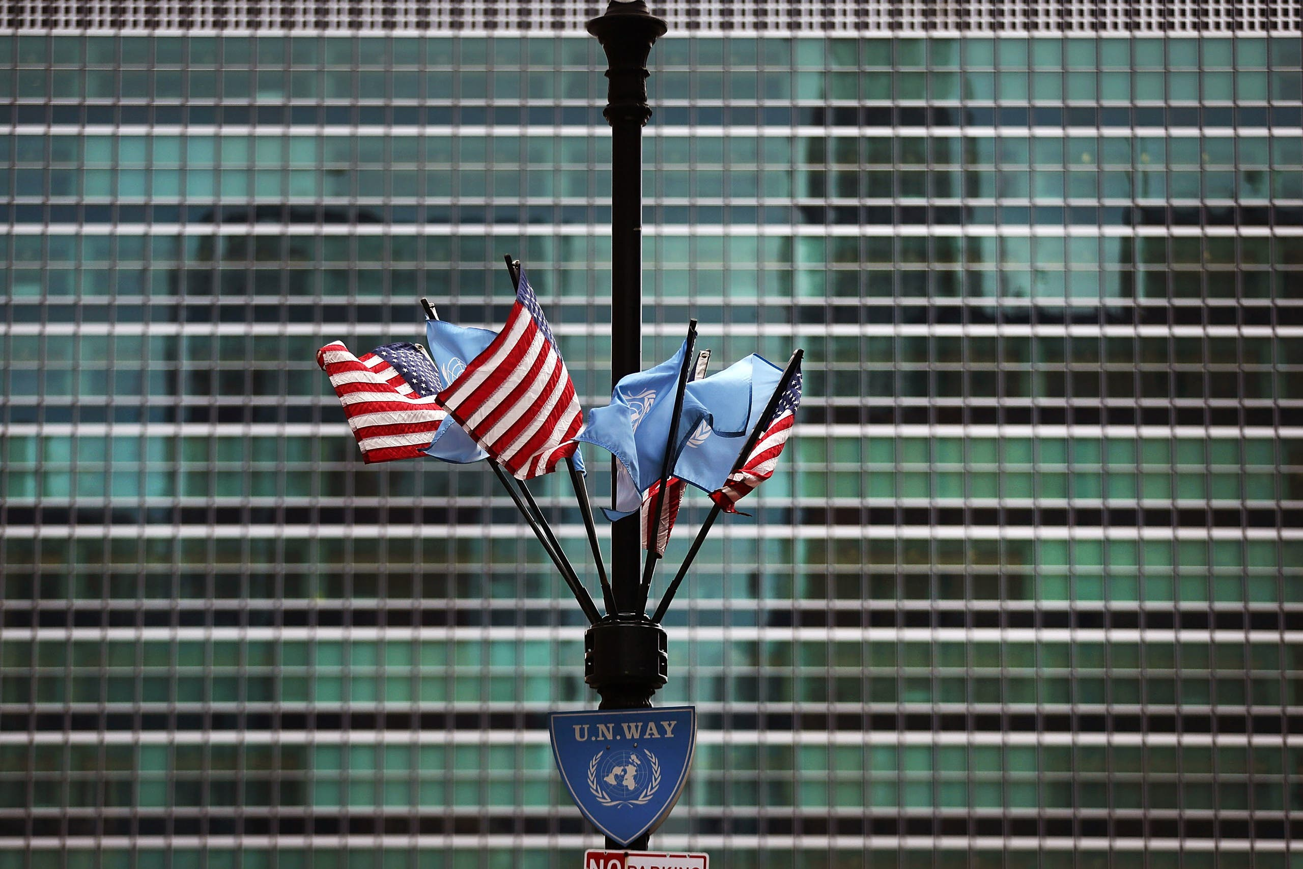 American and UN flags fly outside of the UN following a meeting UN Security Council emergency meeting on April 13, 2018 in New York City. (AFP)