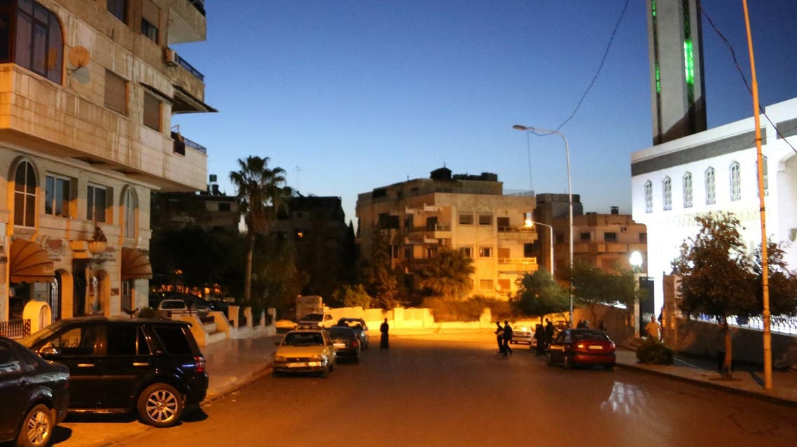 A photo taken in the early hours of April 14, 2018 shows men leaving a mosque in Damascus' Mazze neighborhood after the daybreak Muslim prayer. (AFP)