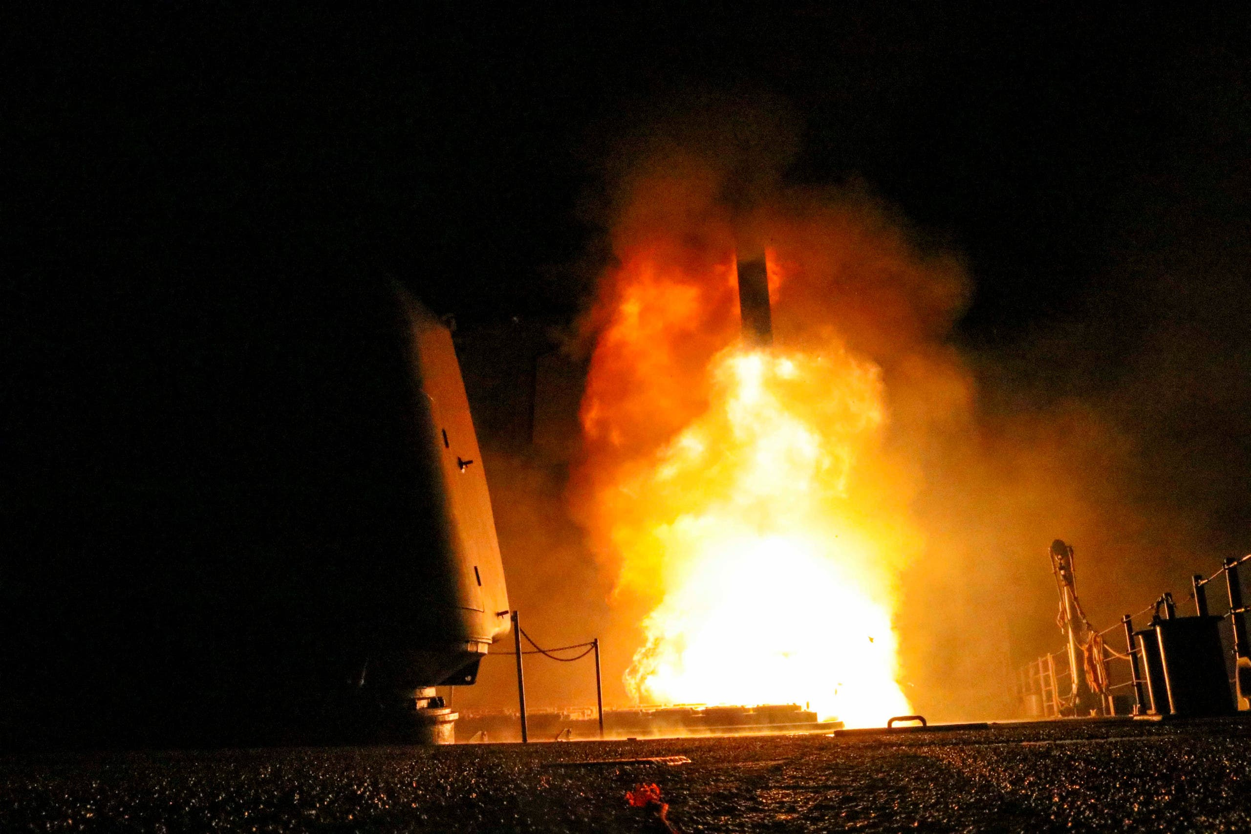 The U.S. Navy guided-missile cruiser USS Monterey fires a Tomahawk land attack missile April 14, 2018. U.S. Navy/Lt. j.g Matthew Daniels/Handout via REUTERS. ATTENTION EDITORS - THIS IMAGE WAS PROVIDED BY A THIRD PARTY