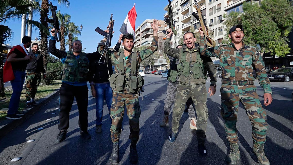 Syrian soldiers chant slogans during demonstrations following a wave of strikes in Damascus, Syria, Saturday, April 14, 2018. (AP)