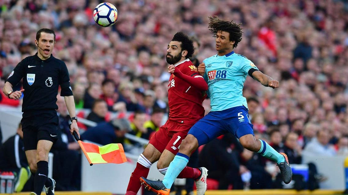 Liverpool's Mohamed Salah (left), and AFC Bournemouth's Nathan Ake battle for the ball during the English Premier League soccer match between at Anfield, Liverpool, on April 14, 2018. (AP)