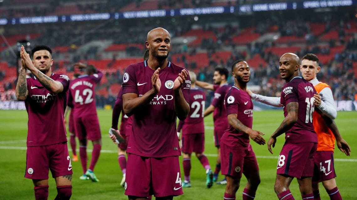 Manchester City's Vincent Kompany and teammates applaud the fans after the match. (Reuters)