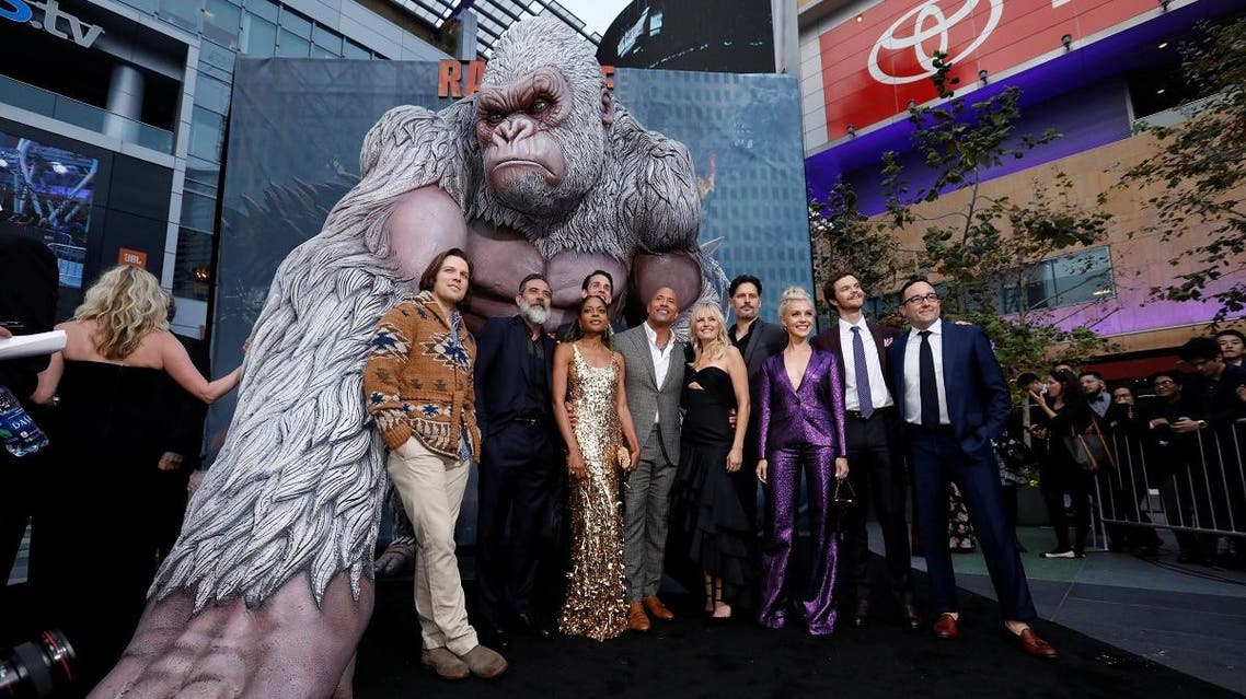 """Cast members Lacy, Morgan, Harris, Liles, Johnson, Akerman, Manganiello, Hill, Quaid and Byrne pose at the premiere for the movie """"Rampage"""" in Los Angeles. (Reuters)"""