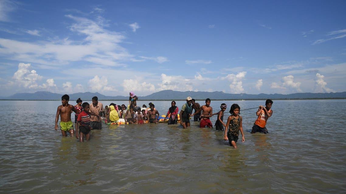 Rohingya refugees sail a makeshift raft across the Naf River into Bangladesh at Sabrang, Teknaf district on November 11, 2017. (AFP)