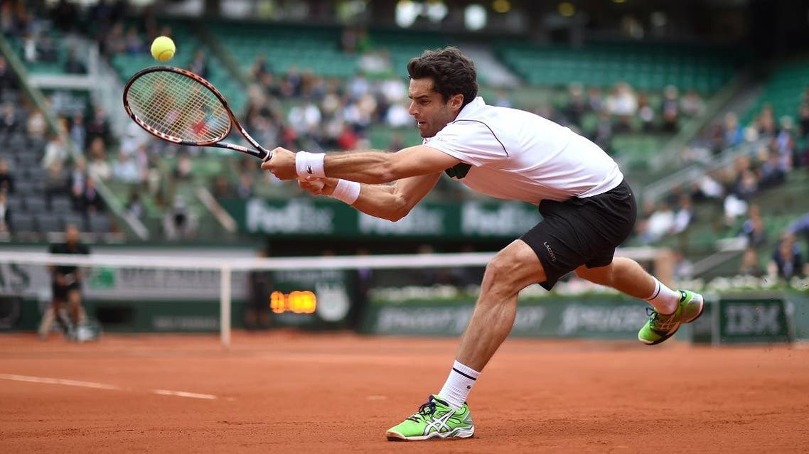 Spain's Pablo Andujar returns the ball to France's Jo-Wilfried Tsonga during the men's third round at the Roland Garros in 2015. (File photo: AFP)