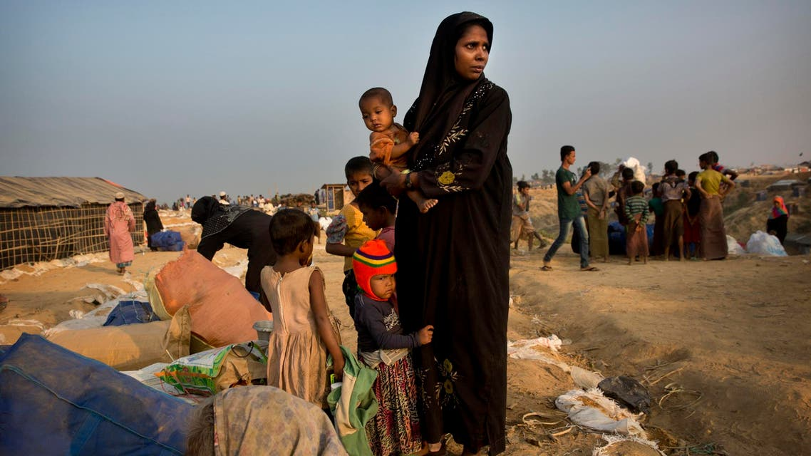 A relocated Rohingya refugee family waits to get allotted a temporary shelter after arriving at Balukhali refugee camp, 50 kilometres (32 miles) from Cox's Bazar, Bangladesh, on Jan. 17, 2018. (AP)